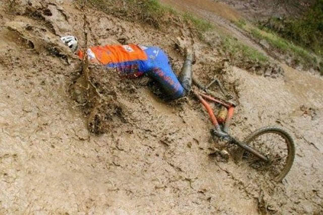 epic fail when a bicycle driver falls into mud[5]
