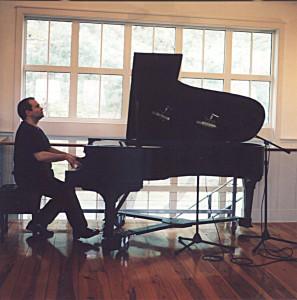 JOSEPH-BERTOLOZZI-Playing-piano-photo-by-Rennie-Pomatti-April-2002